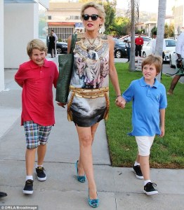 She's no ordinary mom! Sharon Stone, 57, is chic in Versace minidress and blue velvet heels as she takes her two sons out in West Hollywood . Photo from http://www.dailymail.co.uk