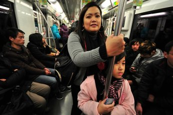 Me and my Jodee in a subway train in Shanghai, December 2011.